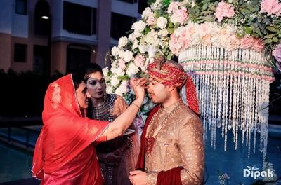 The groom is welcomed before the wedding ceremonies begin