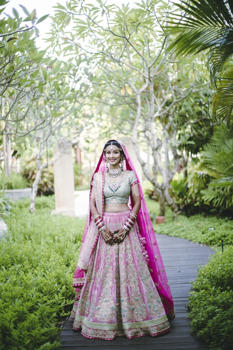 12. A pink and golden lehenga paired with emerald jewellery never fails!