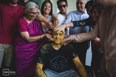 The groom seems to not having so much fun at his haldi ceremony.