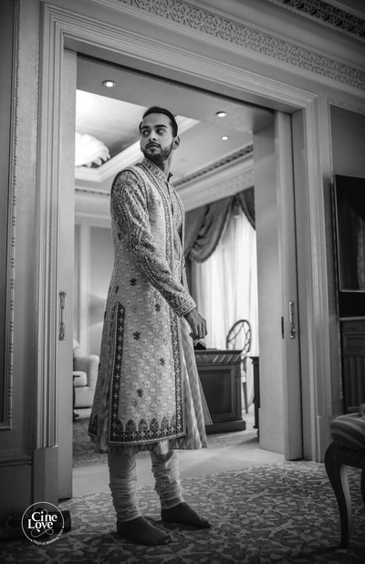 Black and white picture of the groom getting ready