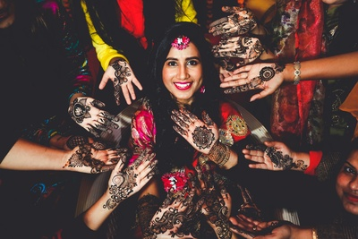 a cute picture of the bride on the mehendi ceremony