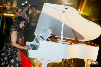 Musicians perform live at the bride and groom's engagement ceremony