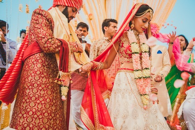 a candid picture of the couple during the wedding ceremonies