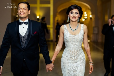 Bride and groom walking into their reception at Fairmont, Jaipur