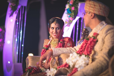 Wedding look enhanced by intricately designed gold jewellery and vibrant makeup