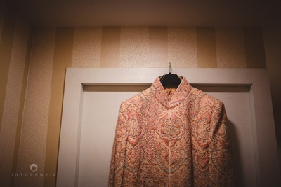 Rose gold and cream wedding sherwani embellished with embroidered motifs by Vig Sons