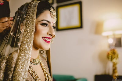 Pretty bride getting ready for the wedding ceremony