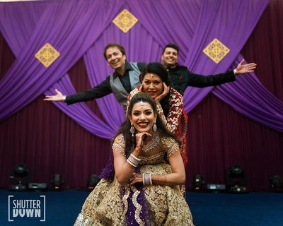 The bride dancing with her family on the sangeet
