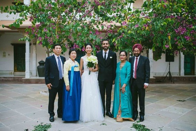 bride and groom in a family shot