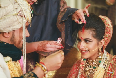 A candid shot of the couple during the sindoor ceremony