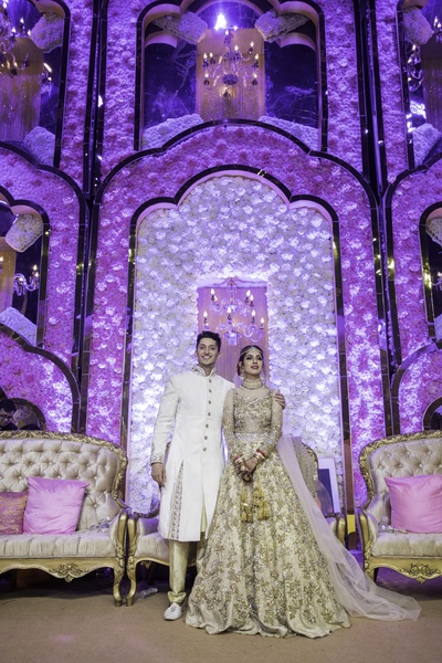 The gorgeous couple wore colour-coordinated outfits for their wedding!