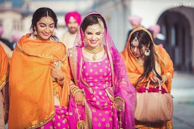 Navi wallking out of the gurudwara with her bridesmaids after the wedding ceremony.