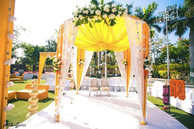 Beautiful Yellow and White drape wedding decor ideas.
