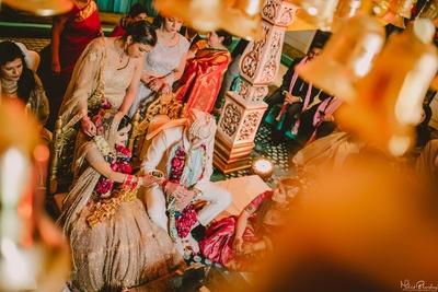 Cute couple following the wedding rituals