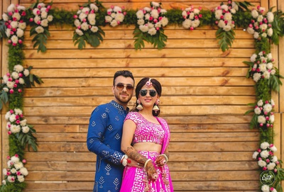 The bride flaunted a fuschia pink blingy lehenga and the groom wore a dark blue kurta at their mehendi ceremony.