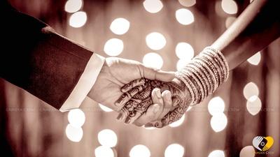 Mehendi designed hands adorned with bangle set