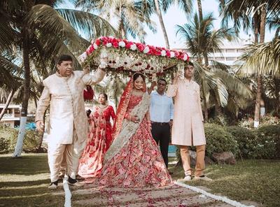 the bride entering under a phoolon ki chadaar