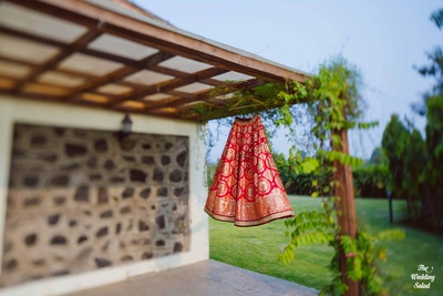 Lehenga shot of the bride's traditional red lehenga captured by The Wedding Salad