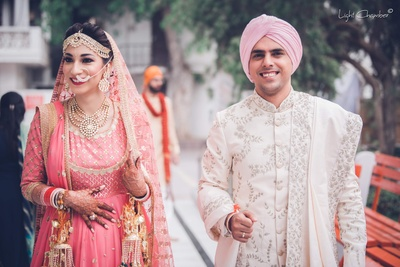 Bride and groom walk together post the wedding at GK1 Gurudwara, Delhi