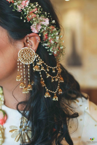 Closeup shot of the bride's statement jewellery for the mehndi ceremony