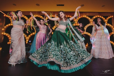 The bride and bridesmaids performing at the sangeet ceremony held at JW Marriott in Mussoorie