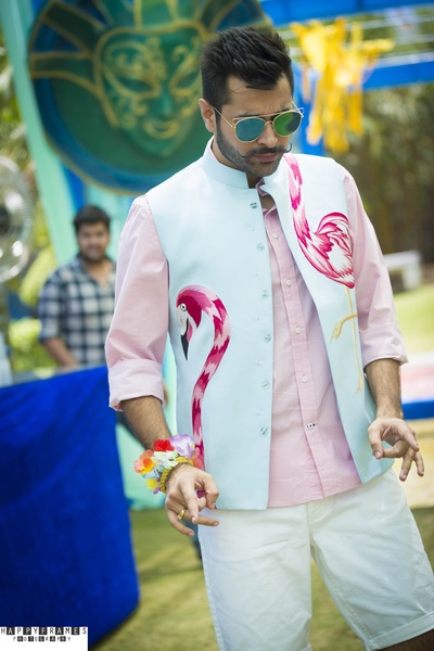 Innovatively designed Nehru Coat of the groom by his own for poolside party celebrated at Radisson Blu Udaipur