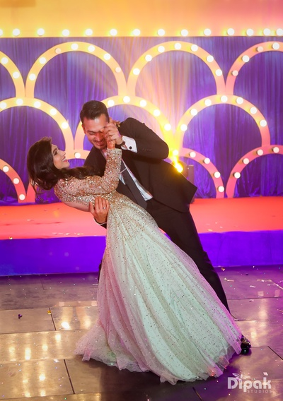 The newly engaged couple shake a leg together!