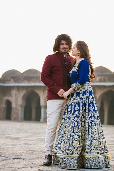 Kriti in royal blue, white embroidered, anarkali and Rohan in maroon bandhgala and white pants.