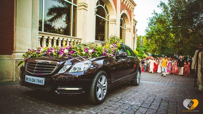 Wedding car decorated in Orchids and white Carnations