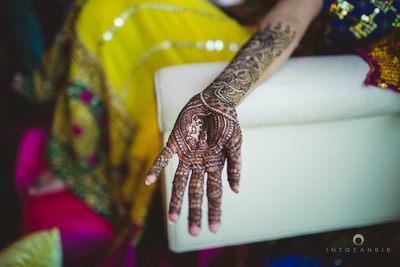 Hand filled with intricate mehendi designs.