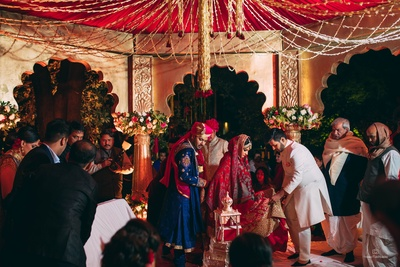 The couple and the family are engaged in rituals at the wedding ceremony!