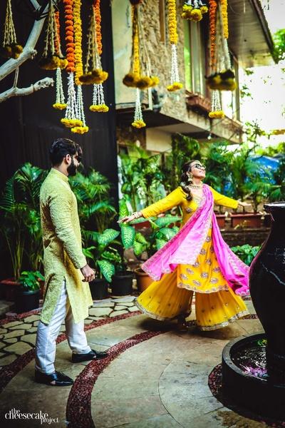 Twirling bride in her haldi shararas