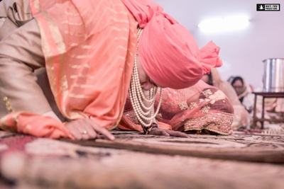 Paying their respects in matching pink and cream wedding attire with pearl and kundan jewellry