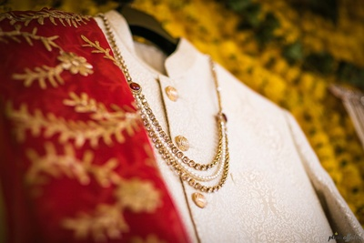 Click of the groom's embossed sherwani for the wedding