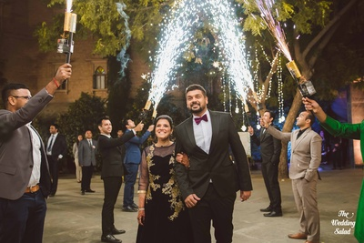 The couple is welcomed with fireworks at their dinner party/ring ceremony.