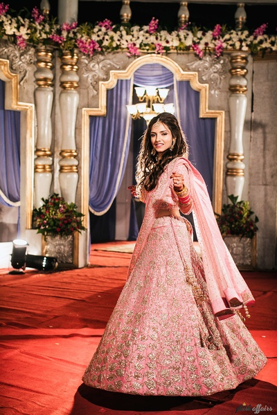 Pink lehenga worn by the bride for her reception party