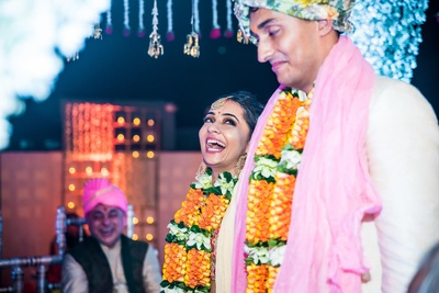 Candid moment between the bride and groom at the wedding mandap