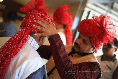 Baraatis decked in red bandhani Safa