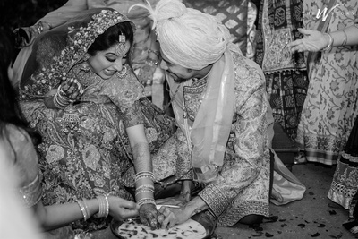 candid capture of the bride and groom during the wedding ceremonies