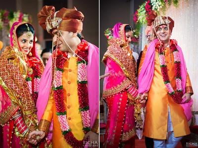 Yellow-orange dhoop-chhaon bandhgala sherwani paired with a metallic bronze safa