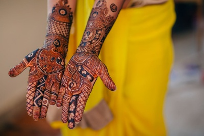 The bride shows off her mehendi design for her hands