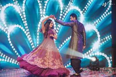 candid capture of the bride and groom dancing at the sangeet