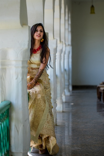 the bride in a dusty ivory leghenga for her mehendi ceremony