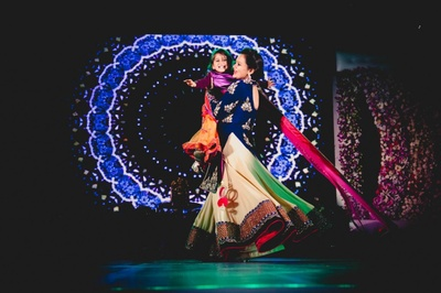 Led effects for evening sangeet with an amazing dance performance in  a combination of navy blue and cream outfit.