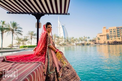 The bride arriving on a boat to her wedding