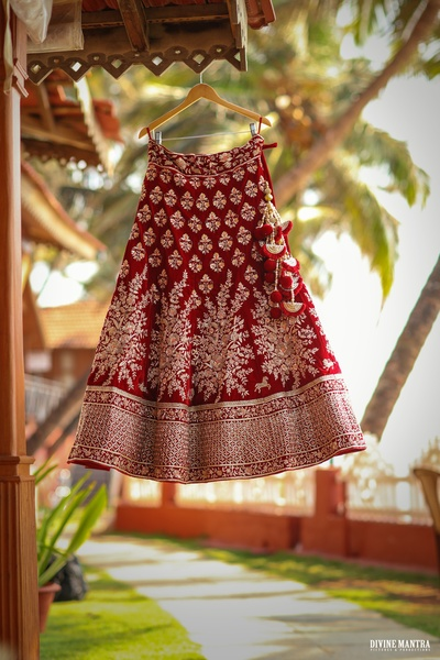 The bride's gorgeous maroon lehenga is all set to be adorned!