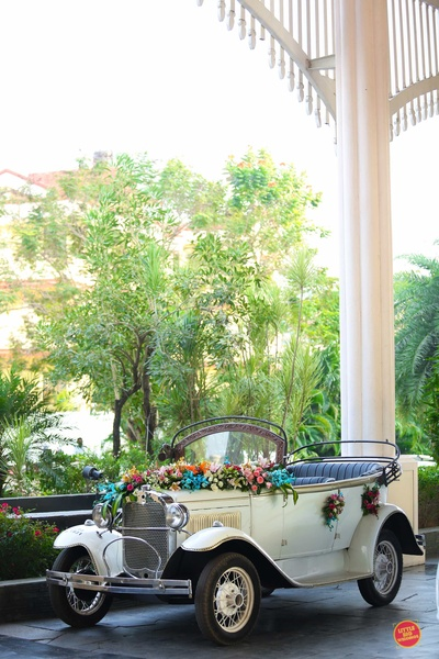 Vintage car decorated beautifully with colorful flowers.