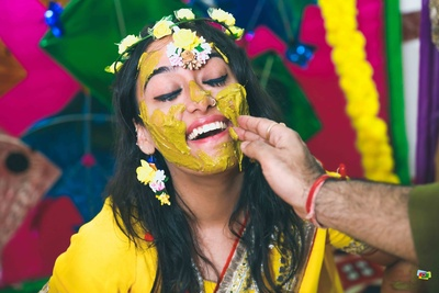Candid capture of the bride during the haldi ceremony