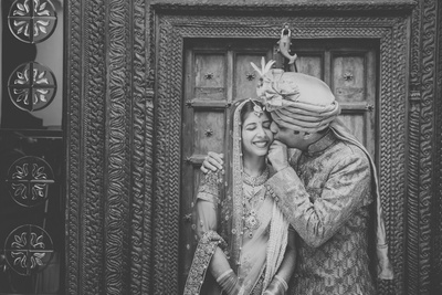 Black and white candid couple photography.