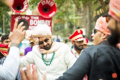 Groom dances in his baraat towards the wedding mandap